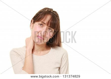 young woman suffers from neck ache on white background