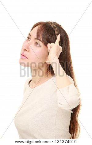 young woman has lost her memory on white background