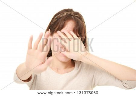 studio shot of young woman making stop gesture