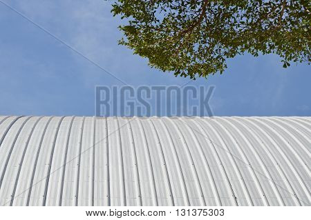 metal roof and tree on sky background