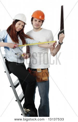 Young pair in a builder uniform with tools.