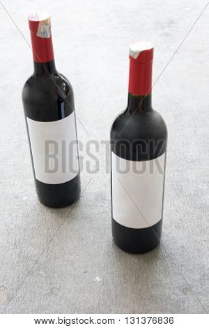 Two red wine bottle with real paper blank label