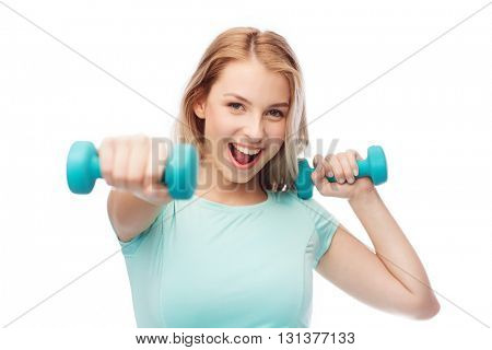 fitness, sport, exercising and people concept - smiling beautiful sporty woman with dumbbell in fight stand