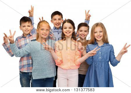 childhood, fashion, friendship and people concept - happy smiling children showing peace hand sign