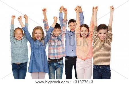 childhood, fashion, gesture and people concept - happy children friends raising fists and celebrating victory