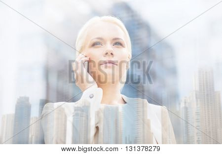 business, technology, communication and people concept - serious businesswoman with smartphone talking over dubai city background with double exposure effect