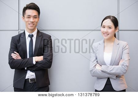 Business people team smile to you in the office shot in Hong Kong asian woman and man
