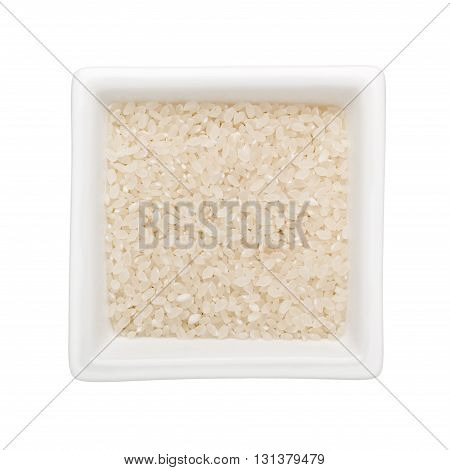 Short grain rice in a square bowl isolated on white background