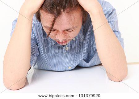 studio shot of perplexed man on white background