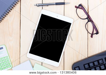 Blank Modern Digital Tablet With Papers And Pen In The Middle Of Office Equipment On Office Desk. To