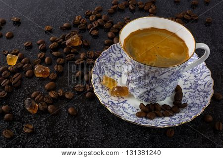 Coffee on black background. Coffee cup. Cup of coffee. Strong coffee. Morning coffee. Coffee break. Coffee mug. Strong coffee.