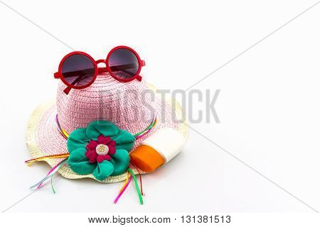 Woven hat with red sunglasses on white background.