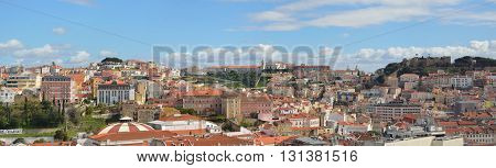 Panoramic view from the Miradouro de Sao Pedro Alcantara including Castelo de Sao Jorge, Igreja da Graca and Miradouro de Graca. Lisbon