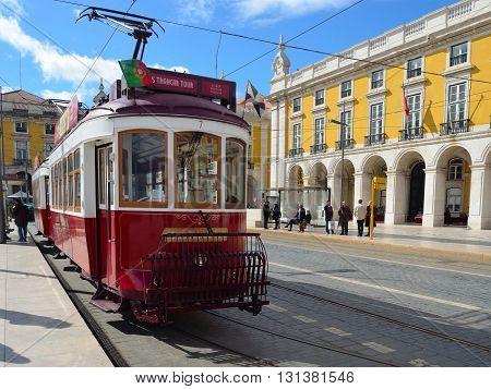 Lisbon, Portugal - March 04, 2016: Vintage Tourist Sightseeing  Tram on the Praca do Comercio  Lisbon Portugal.