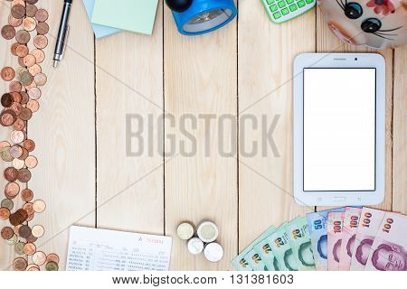 Blank Modern Digital Tablet With Money And Saving Account Passbook, Book Bank Statement In The Middl