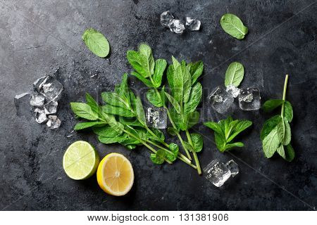 Mint, lime and ice on stone table. Top view