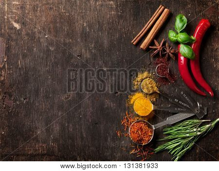 Herbs and spices on wooden table. Top view with copy space