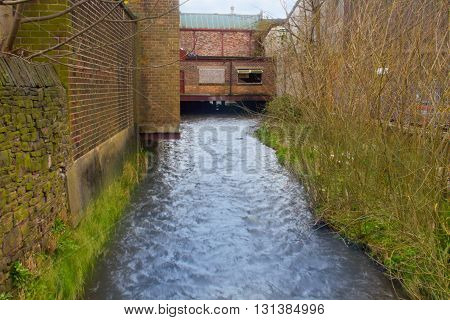 A River And A Bridge In A Run Down English Town