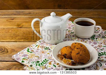 Teapot and cup of tea copy space. Homemade biscuit. Homemade cookies.Sweet dessert. Breakfast cookies. Sweet pastry. Cup of tea. Tea cup. Breakfast tea.