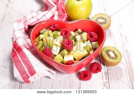 fruit salad in heart bowl