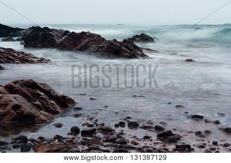 Long Exposure Shot Of The Sea Coming In