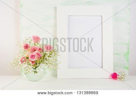 Frame mockup with roses in vase. Frame mockup. Poster Mockup. Styled mockup. Product mockup. Design Mockup. Empty frame mockup. White frame mockup. Portrait frame mockup.