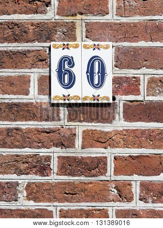 House Number On A Red Brick Wall In The Netherlands