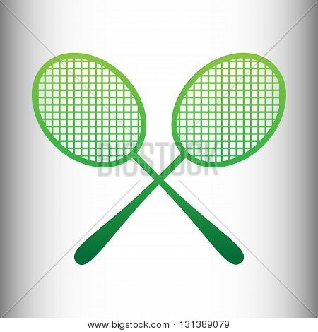 Tennis racquets icon. Green gradient icon on gray gradient backround.