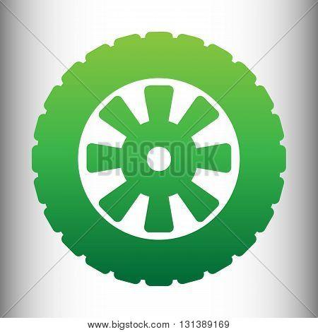 Road tire icon. Green gradient icon on gray gradient backround.