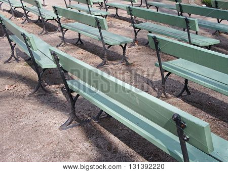 Uniformity: A lot of wooden Benches in the same direction
