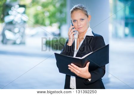 Portrait of a busy businesswoman at work