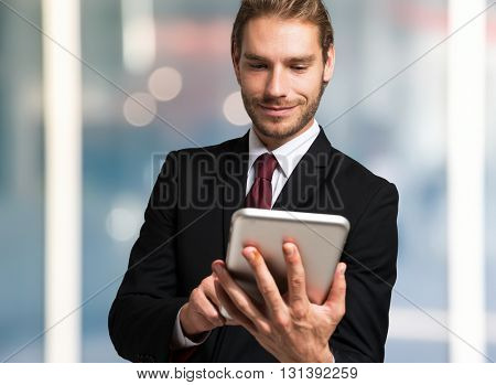 Businessman using a digital tablet in an urban environment