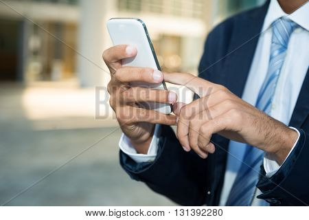 Detail of a man using his mobile phone
