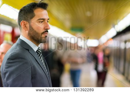 Businessman waiting for the subway