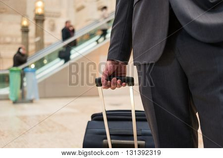 Detail of a traveler pushing his trolley
