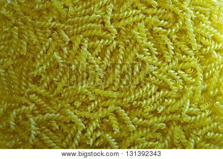 Pasta gimlet texture background. Pasta is a staple food of traditional Italian cuisine.