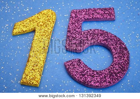 Number fifteen yellow purple color over blue background. Anniversary. Horizontal