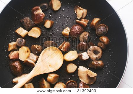 a boletus mushrooms fried in a pan