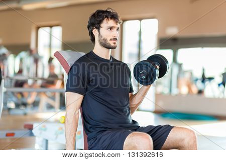 Athlete Working Out Biceps