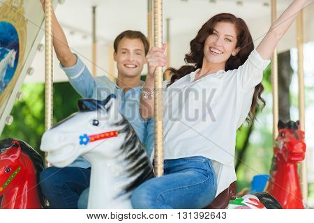 Happy couple riding a rollercoaster