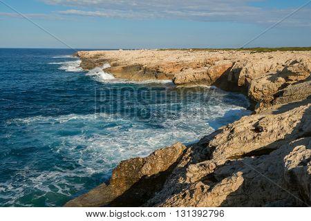 Wonderful sunny day on the coast the sea waves breaking on the rocky coast. Cyprus Akamas peninsula.