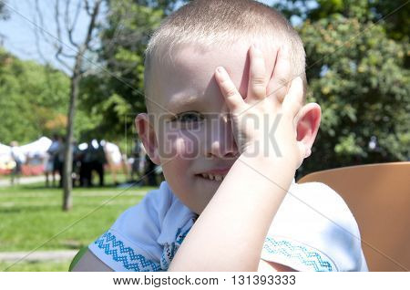 shy little boy playing in the park