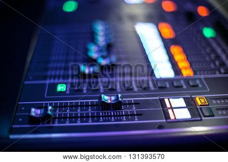 Blurred panel of the stage controller with slider - closeup background