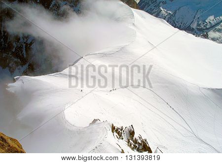 Paths of tourists on the slopes of Mont Blanc France.
