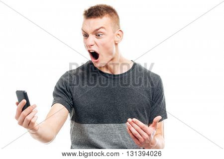 Angry man screaming on the phone isolated on a white background