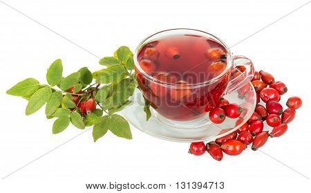 Rosehip berries, a cup of tea isolated on white background.