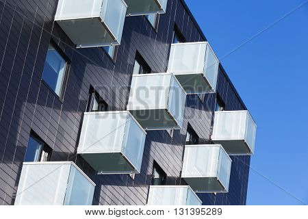 Cube Shaped Balconies With White Glass Railings