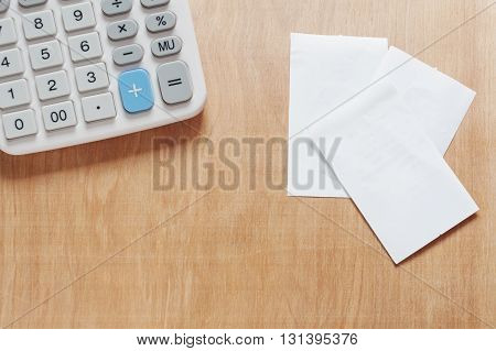 Bill and calculator on wooden, Bill for income and expenditure