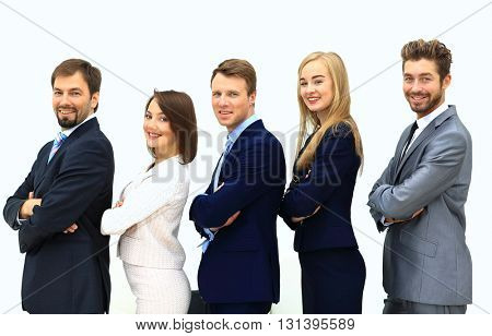 Smiling business team standing upright with their hands on their
