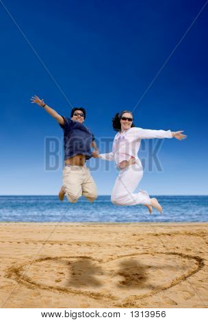 Beach Couple Jumping Of Joy